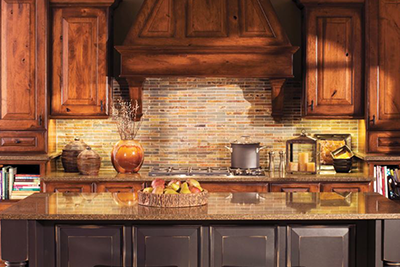Mix it up. All trends point to mixing woods and finishes in cabinets, featuring Dura Supreme custom kitchen cabinets available from Lumberjack's Kitchens and Baths in Akron