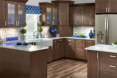 Dark chocolate brown custom kitchen cabeints by Mid Continent kitchen cabinets, available at Lumberjack's Kitchens and Baths in Akron OH.